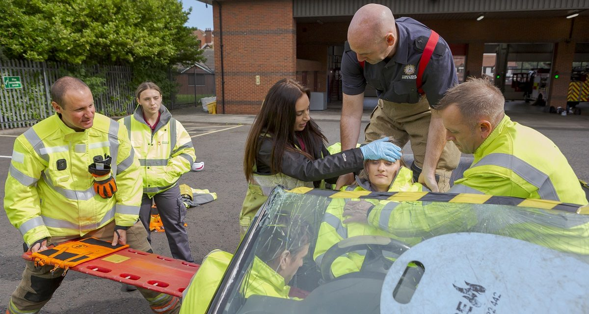 Student paramedics learn lifesaving skills during traffic crash exercise