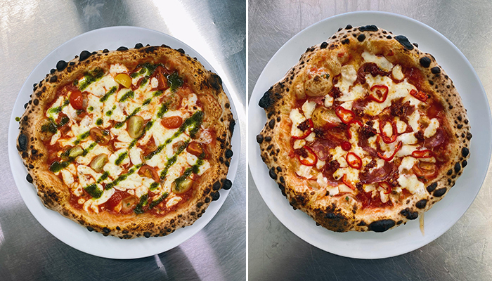 """The """"Wild Fire 2.0"""" pizza with san marzano tomatoes, fior di latte, nduja and salami, and the """"Fresh Prince"""" pizza with san marzano tomatoes, fior di latte, and vine tomatoes"""